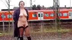 lady flashing a train