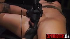 Sabrina drilled by sextoy while being held inside the van