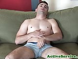 Muscular cadet tugging his throbbing cock