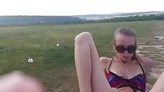 Two girls squirt and piss outdoors