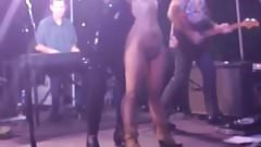 sexy nude girl in boots on public concert stage