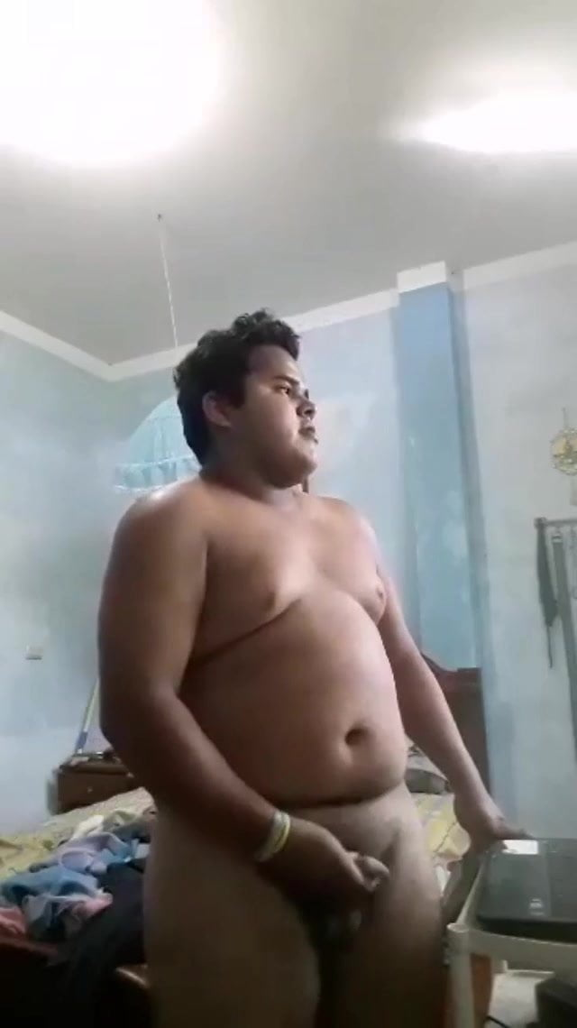 Chubby enjoying music and masturbating on the similar time