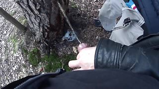 my boyfriend holding my pissing cock outdoor in the woods