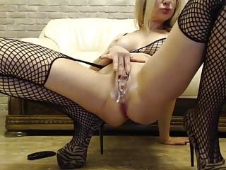 Blonde in fishnets playing with her juicy wet pussy