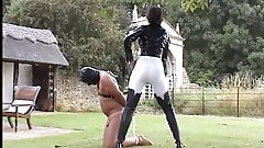 whipping her slave outside