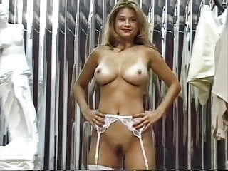 Unbelieveably hot blonde cutie poses as an office chick