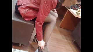 candid try heels in shoes shop