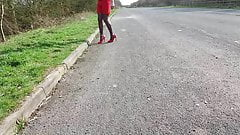 walking in red heels and skirt