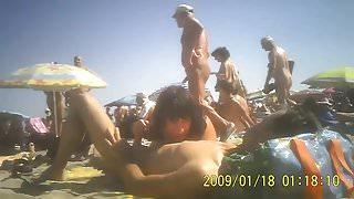 Milf sucking husband's dick in public beach