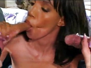 Two businessmen get their cocks sucked by petite black beauty