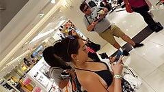 Candid voyeur hottie with leg tattoo bikini top shopping