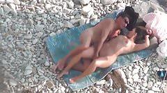 Mature couple passionately fucks on the beach