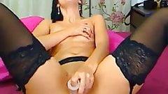 Amazing brunette in her garter belt masturbating