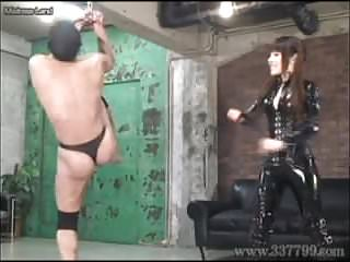 Japanese Femdom whips violently against a slave