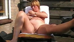 Housewife plays in garden with herself