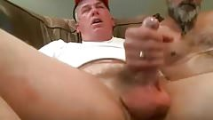 Two Dads masturbating each other