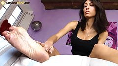 Barefoot babe gives herself a cream foot massage