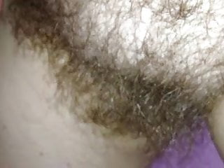 super close up of her shiny hairy bush.