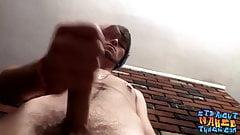 Bearded straight guy strokes oiled up dick until jizz flies