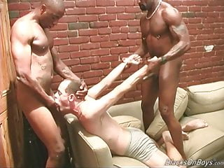 Middle aged white guy getting shared by black men
