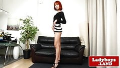 Redhead ladyboy pulling her big cock solo