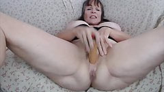 Slutty MILF penetrates huge asshole and pussy