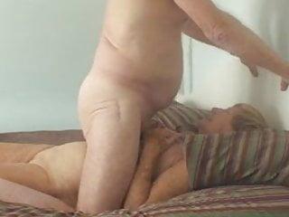 Grandpa and grandma enjoys on bed