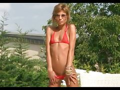 Bikini Pleasure-Blond Girl in red micro Bikini Pool
