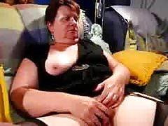 Chubby mature rubs on her sofa