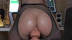 Riding a huge dildo in stockings