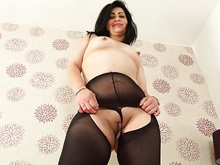 English milf CandyLips looks hot in black tights