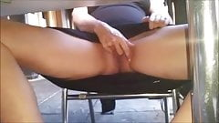 Rubbing her pussy at public cafe