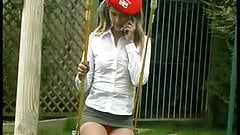 Teen in extreme mini skirt outdoor on a swing