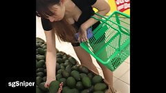 Downblouse - MILF showing off in NTUC