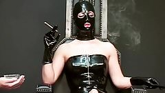 latex mistress with two males