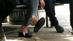 Candid feet dangle