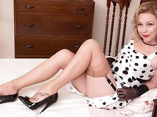 Blonde babe Lucy Lauren wanks in vintage nylons and garters