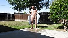 A daddy opening his towel and peeing in public.