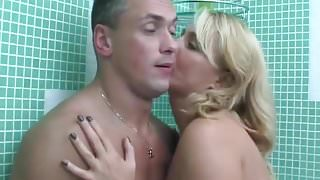 Mature seduces a guy in the bathroom