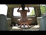 Hot brunette rides dildo in back of suburban