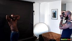 Ebony hunk cocksucking during photo shoot