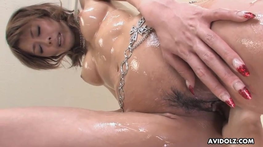 Japanese temptress, Rina is getting her lubed pussy fingered