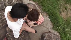 Horny couple do oral outdoors wearing sunglasses