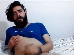 gay bearded young cub plays with his cock and nipple