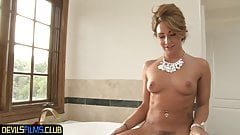 Glam beauty takes a steamy solo bath