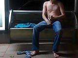 Wanking shirtless at a public bus stop