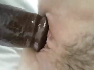 YOUNG HOT WIFE RIDES HUGE BLACK DILDO. PART 1