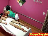 Asian masseuse jerks and slides on client