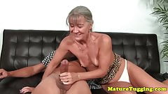 Mature granny tugging cock on