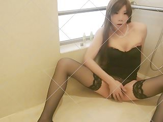 Asian Sissy Crossdresser uses Wine Bottle Dildo